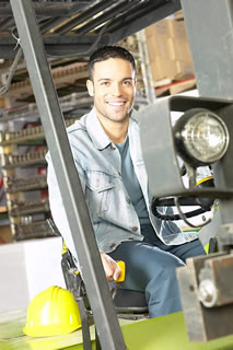 Agriculture Smiling man operating machinery - Business Insurance