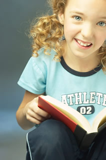 Education Smiling little girl with red book 2 - Home